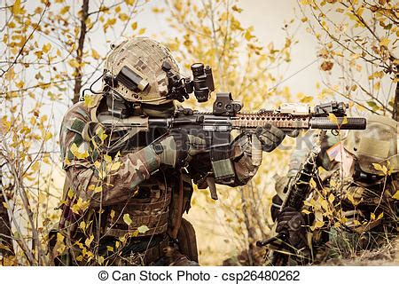 Soldiers team aiming at a target of weapons